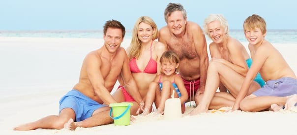Multi Generation Family Having Fun On Beach in Jamaica on Holiday