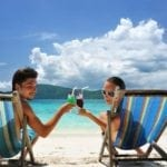 Couples-On-The-Beach in jamaica with drinks