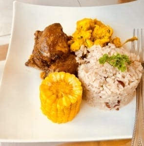 Jamaican jerk chicken, curry lobster, rice and bean with corn