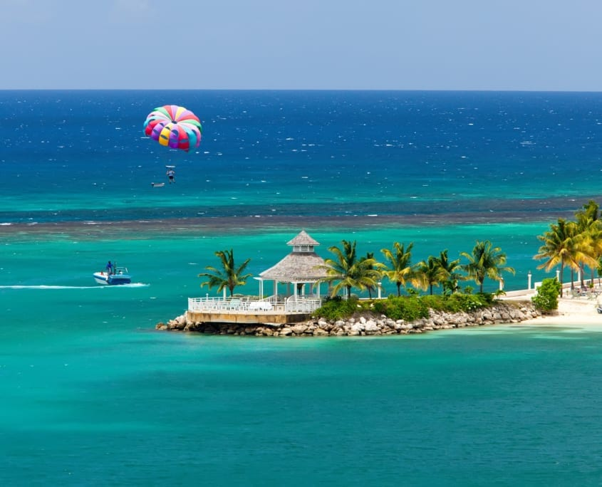 Parasailing over the tropical island of Ocho Rios, Jamaica.