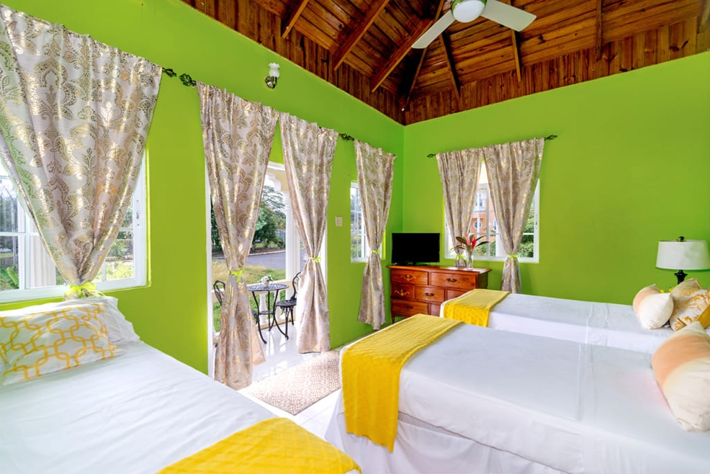 Jamaica villa twin bedroom with ocean view from balcony