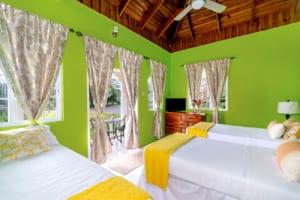 Jamaica villa twin bedroom with ocean view from balcony
